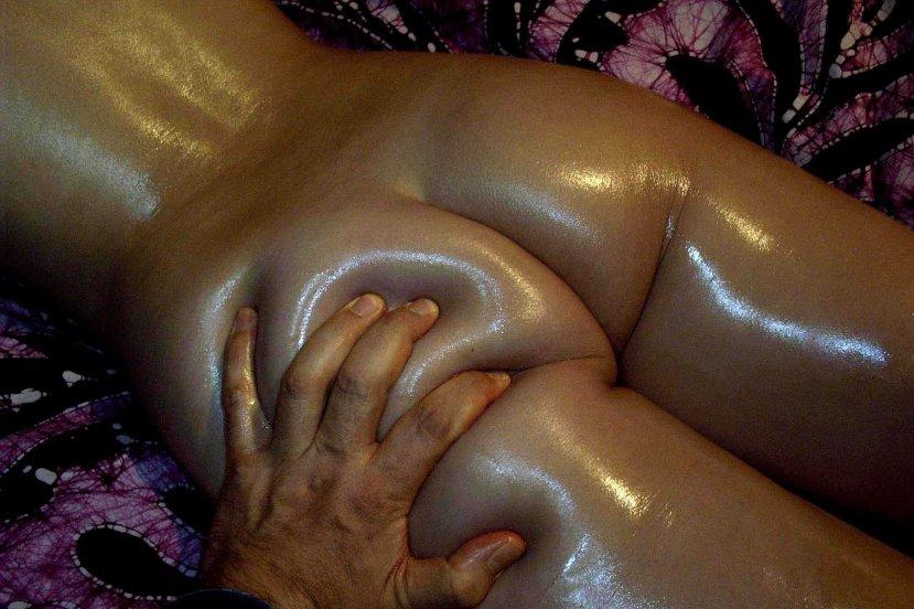 hand massaging butt