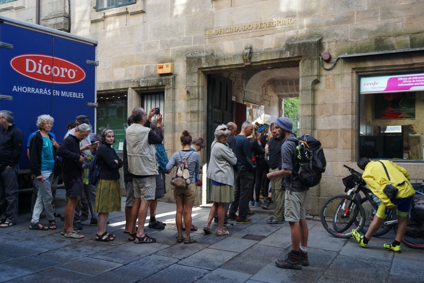 Pilgrims receiving the Compostela